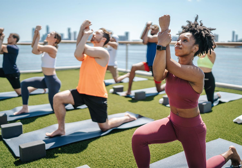 Chelsea Piers Fitness Members Practicing Outdoor Yoga